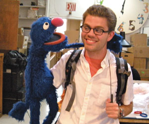 Myles Hunt '11 chats with Grover at the Jim Henson Company in New York City.